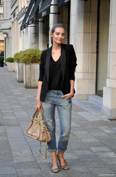 woman in black blazer and jeans