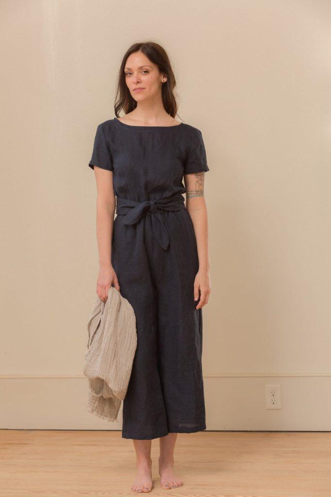 woman wearing a black jumpsuit