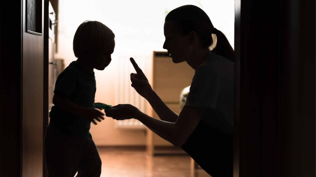 woman disciplining her child