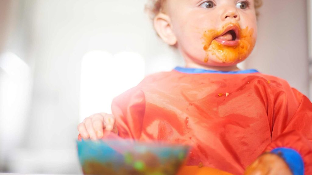 toddler with food on face