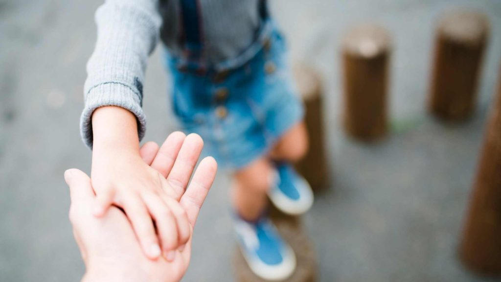 child holding their parents hand