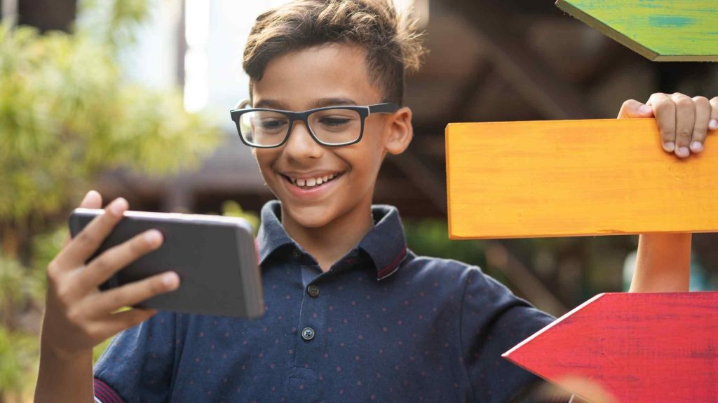 kid using phone